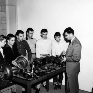 G. B. Gray instructing Gaston Technical Institute students in automotive transmissions