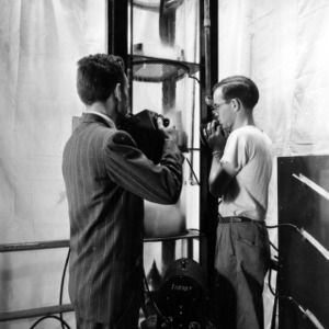 Dr. D. S. Arnold and Charles Plank conducting distillation research