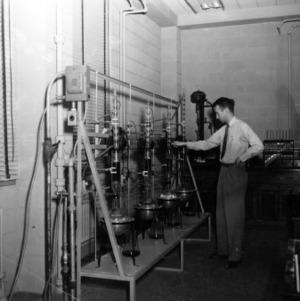 Don E. Carter extracting tannin from pine bark
