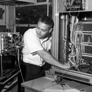 Chemical Engineering electronic technician checking signal levels on a computer interface in the Digital Computing Center