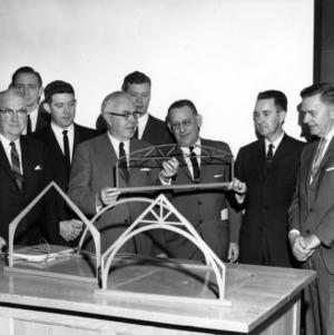 Engineers examining civil engineering models