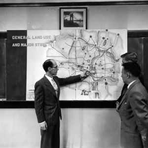 Professor Willard F. Babcock and other with Civil Engineering map layout