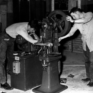 Men operating Stokes Automatic Press