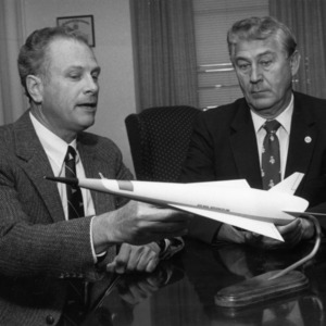 Dr. Fred R. DeJarnette and Chancellor Bruce R. Poulton with model of NASA's proposed hypersonic space plane