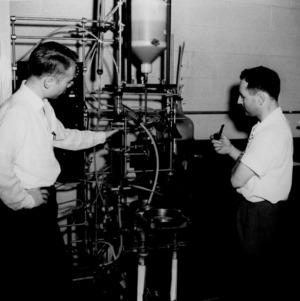 David Hansen and Dr. Eugene E. Erickson look over liquid-solid contacting equipment