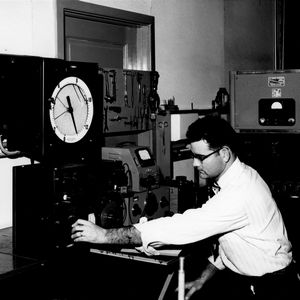 Bobby L. Joyner making electrical measurements on a ceramic dielectric