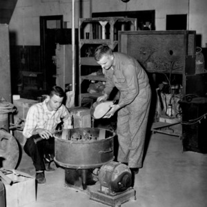Bernard McLawhorn and James Tanner mixing ingredients in Simpson mixer