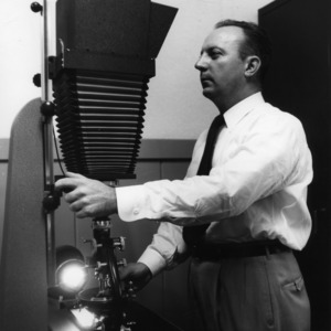 Dr. William C. Bell using petrographic microscope
