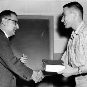 Robert Kennel receiving the Physics Achievement Award from Professor J. S. Meares