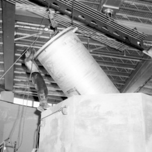 Bob Weedland directing tank into nuclear reactor shield