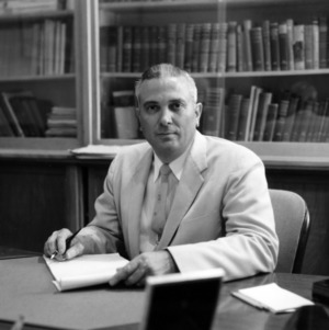 Dean Arthur C. Menius, Jr. at desk