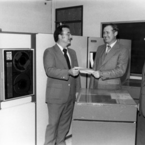 Dean Larry K. Monteith and Dr. Paul Turinsky, receiving donation of computer system from Carolina Power and Light Company, as represented by Lynn W. Eury