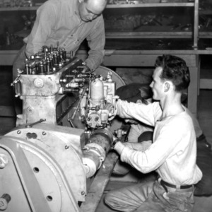 Diesel Engineering students are shown inspecting a small diesel engine