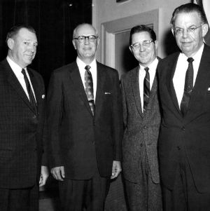 William C. Friday and others at event