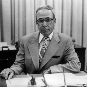 Ralph E. Fadum at desk