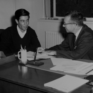 Ralph E. Fadum and other at desk