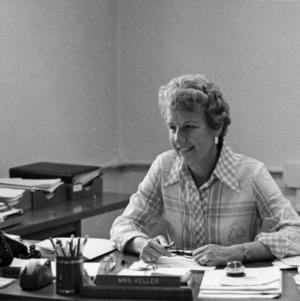 Anne Keller at desk
