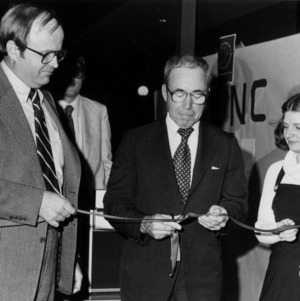 Ralph E. Fadum cutting ribbon at event