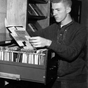 Electrical Engineering student examining placement files