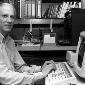 Mike Riddle at computer