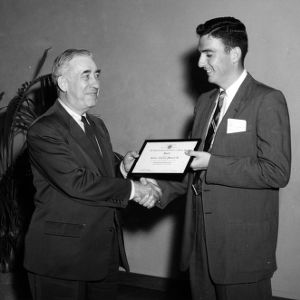 A. J. Fox presenting award to Civil Engineering senior J. E. Powell, Jr. at ASCE meeting
