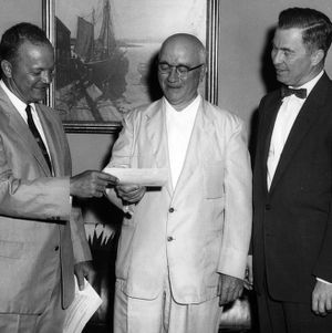 Chris Webster of Westinghouse presenting check to Dean J. Harold Lampe and James A. Babcock
