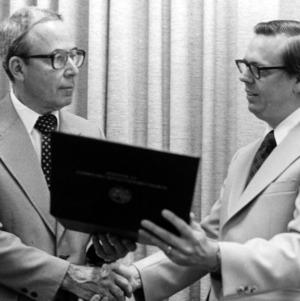 Dean Ralph E. Fadum presenting award to Dr. John R. Hauser