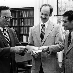 Dr. Larry K. Monteith presenting Dr. Vernon C. Matzen, with Dr. Paul Z. Zia