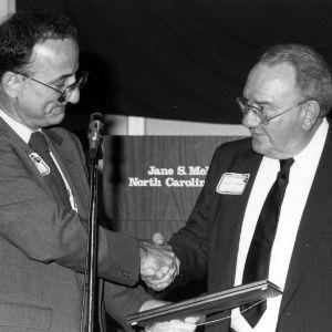 Dean Larry K. Monteith presenting Distinguished Engineering Alumnus Award to William F. Troxler