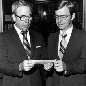 Dean Ralph E. Fadum and others with check