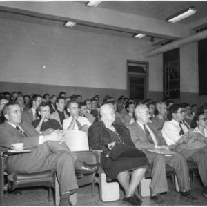 Arthur C. Menius, Charlie Plank, and Roger Kirk in audience
