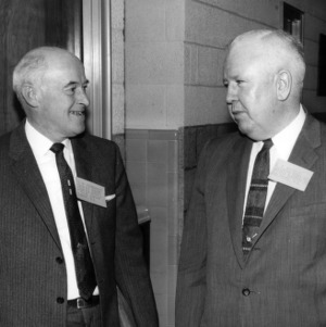 A. M. Fairbrother, Division Manager for Champion Paper and Fiber Company, and S. C. Donnelly, Assistant Works Manager of Western Electric Company