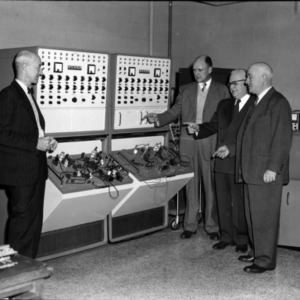 Group examining electronic analog computer