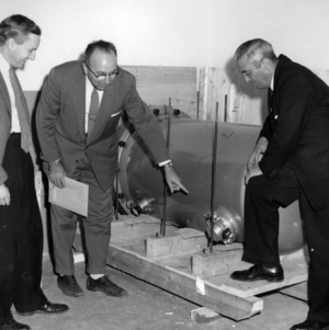 Dave Martin, Art Waltner, and Buch Menius with equipment