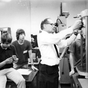 King Brose and students in laboratory