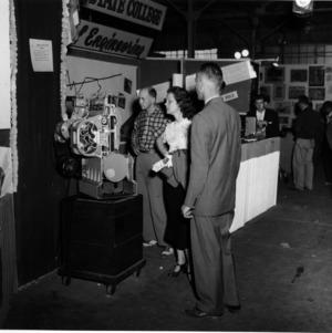 Crowd viewing a diesel engine display at NC State Fair