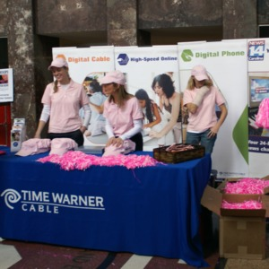 Handing out pink gear for the Hoops for Hope game
