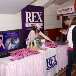 Rex Healthcare handing out pink gear for at Hoops for Hope