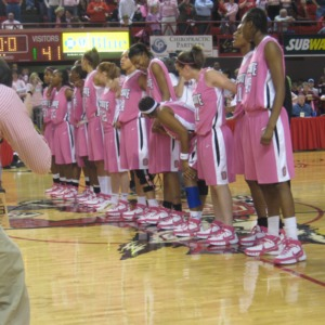 Wolfpack Women's Basketball team lining up for Hoops for Hope game against Boston College