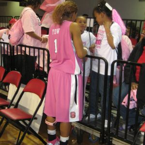 Women's basketball players sign autographs for their fans at Hoops for Hope