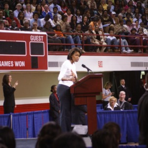 Michelle Obama speaking at a rally in Reynolds Coliseum