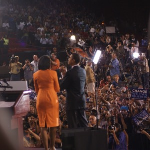 Barack Obama and his wife Michelle on stage at a rally in Reynolds Coliseum