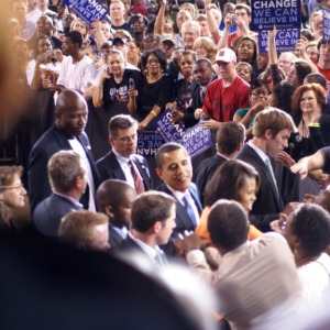 Barack Obama and his wife Michelle walk through the crowd at a rally in Reynolds Coliseum