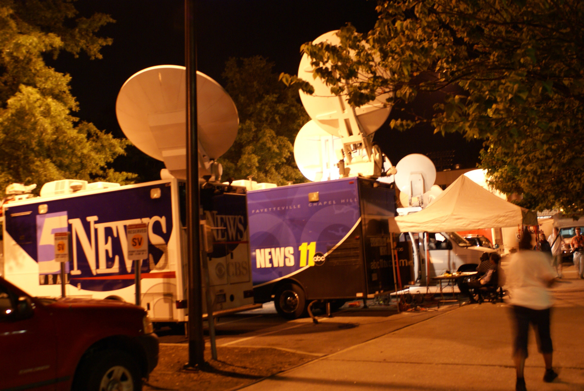 Media trucks outside after the Barack Obama rally