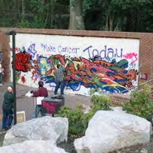 Students painting the Free Expression Tunnel