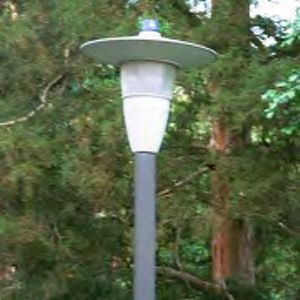Older pole lights that look like alien spacecraft are being replaced across campus