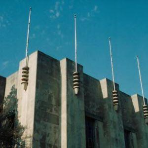 Flag poles atop Reynolds Coliseum