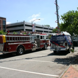Reynolds Coliseum fire, emergency and news vehicles