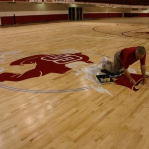 Reynolds Coliseum, floor repainting