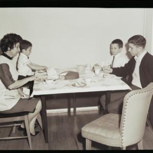 Johnny, Edward, Mary and Douglas Mattox at table with cake, January 27, 1964